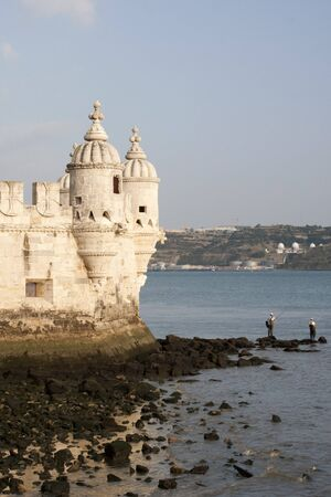 Torre de Belem Tower in Lisbon Portugal with Fisherman