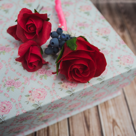barrette and buttonhole of artificial flowers Stock Photo