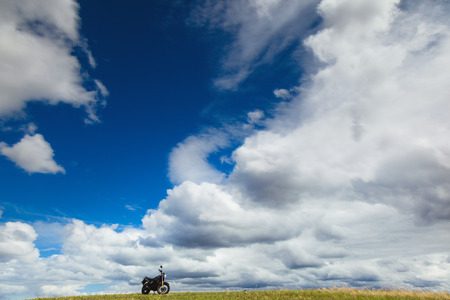 the arable land: motorcycle on a field on a sunny day