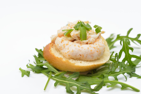 Sandwich with Fish Roe Salad on Rucola Leaves, Isolated on White Background