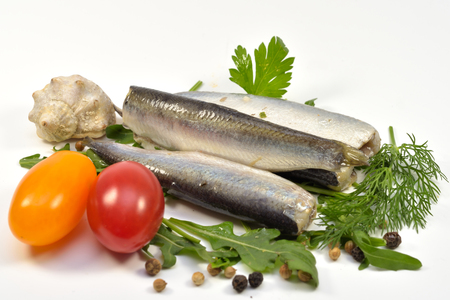 Marinated Herring with Herbs and Vegs, isolated on white background Foto de archivo