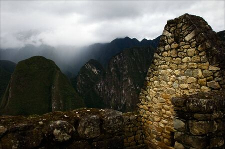 grandiose: Ancient walls. Machu Picchu. A stone laying of an ancient grandiose construction in high mountains Andes.