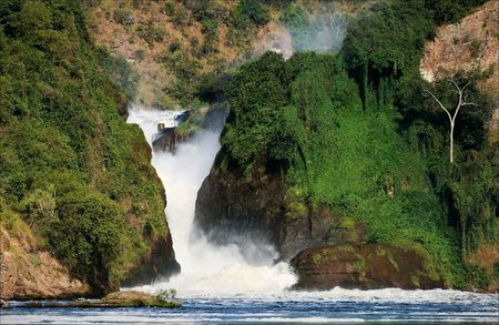 Uganda: Murchison  falls roar, clamped between two rocks covered with greens. Stock Photo