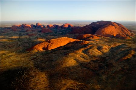 The highest monolith, Mount Olga in brightly red color of the coming sun. Stock Photo