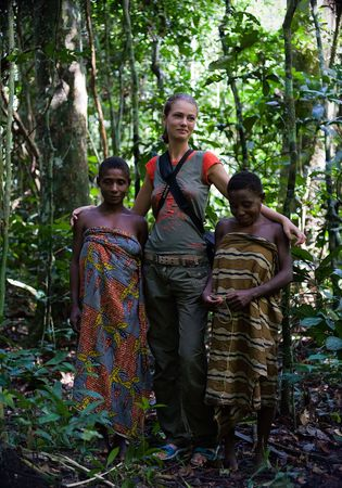 Africa. Jungle of the Central-African Republic. On November, 2nd, 2008. Girls from tribe Baka with the white woman.