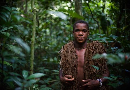 Africa. Jungle of the Central-African Republic. On November, 2nd, 2008. The hunter-pygmy with a net. The hunter-pygmy with a net before hunting. Stock Photo - 8075884
