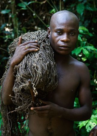 pygmy: Africa. Jungle of the Central-African Republic. On November, 2nd, 2008. The hunter-pygmy with a net. The hunter-pygmy with a net before hunting. Editorial