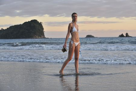 Young beautiful on a beach. One. Coast Pacific of ocean in Costa Rica. Stock Photo - 8095028