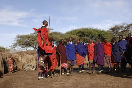 Africa.Tanzania. 5 march 2009. Maasai village. Masai performing warrior dance,Tanzania, East Africa. Stock Photo - 8150606
