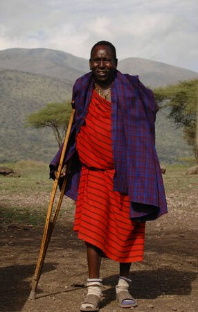masai: Africa.Tanzania. 5 march 2009. Maasai village. Portrait elderly maasai. Village maasai in savanna. A shining sun.