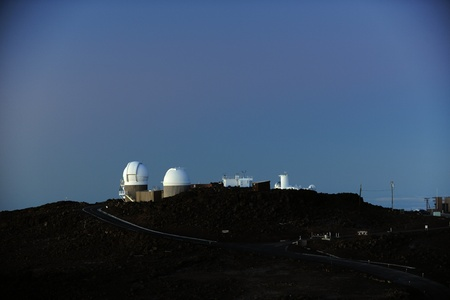 Astronomical observatory in mountains early in the morning. photo