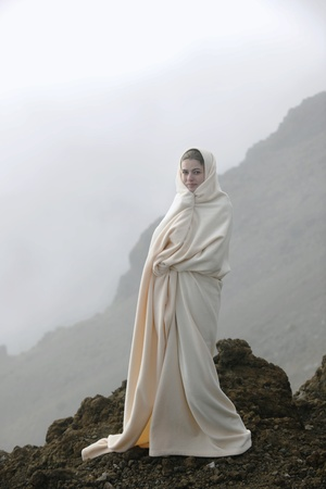 The girl shrouded in a cloud, it is high in mountains, early in the morning. Stock Photo - 8821338