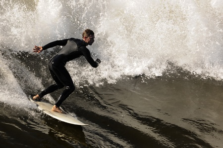 Surfer gets up on a wave. The wave twists with foam and splashes. Stock Photo - 9057834