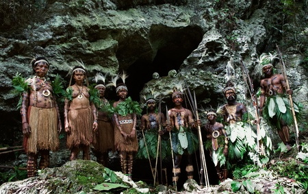 INDONESIA, NEW GUINEA, SECTOR SENGGI - 2 FEBRUARY 2009 : Tribe of Jafi in traditional clothes, ornaments and a coloring. New Guinea Island, Indonesia. warrior of a Papuan tribe of Yafi in traditional clothes, ornaments and coloring. New Guinea Island, Ind