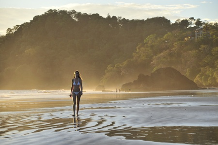 Young beautiful on a beach. One. Coast Pacific of ocean in Costa Rica. photo