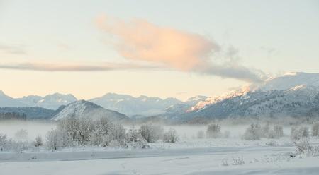 The Chilkat Valley under a covering of snow, with mountains behind. Southeast Alaska. Stock Photo - 11555668