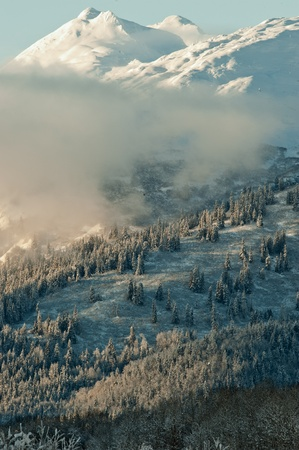 southeast alaska: The Chilkat Valley under a covering of snow, with mountains behind. Southeast Alaska.