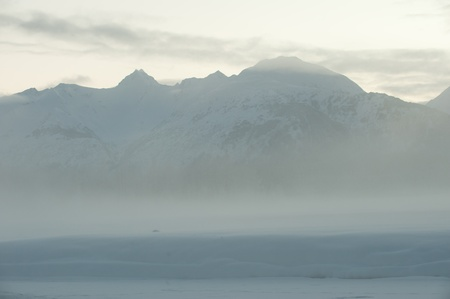 The Chilkat Valley under a covering of snow, with mountains behind. Southeast Alaska. Stock Photo - 11555663