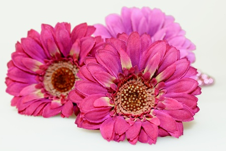 Three artificial Pink Gerbera isolated on the white background