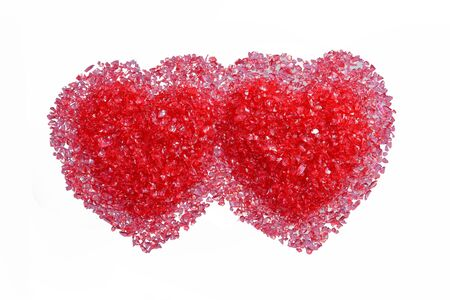Two hot red hearts on a white background. Isolated on white photo