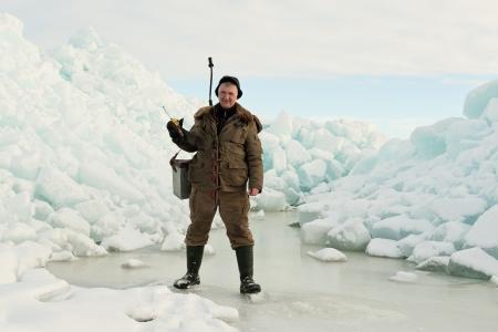 Ice Fishing  Fisherman with equipment for fishing on Ladoga Lake photo