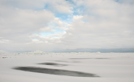 Winter Ladoga Lake  Ice, snow, clouds     Russia photo
