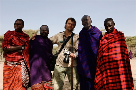 MASAI MARA,TANZANIA, - MARCH 5: Photographer Sergey Uryadnikov on a visit at Massai. Massai in traditional clothes welcome the guest. The Maasai (also Masai).  5 March 2009 In Maasai village, Africa, Tanzania.