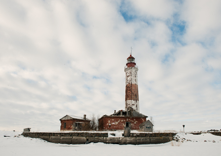 Winter Lighthouse  The Lighthouse island in the winter on the Ladoga Lake  Russia  photo