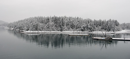 Fishing vessel at the snow-covered mooring. photo