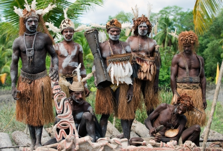 PAPUA (IRIAN JAYA), ASMAT , INDONESIA : JANUARY 18: Asmats headhunters and woodcarver in traditional and national tribal customs, dresses  on January 18, 2009 in Papua (Irian Jaya), Indonesia.