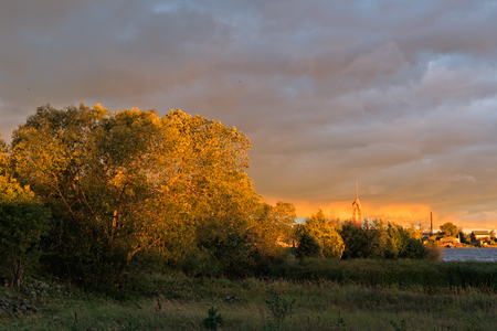 Rising with thunderclouds on the Volkhov river bank.  Volkhov. Russia photo