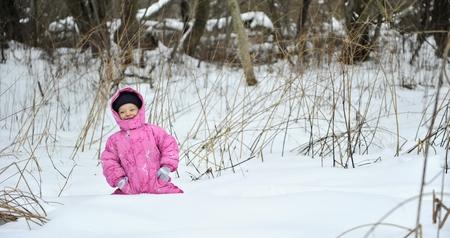Little winter girl in fairy ice forest running  photo