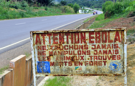 visitors area: MAKOUA, CONGO, AFRICA - SEPTEMBER 27: A sign warns visitors that area is a Ebola infected. Signage informing visitors that it is a ebola infected area. September 27, 2013,Congo, Africa. Editorial