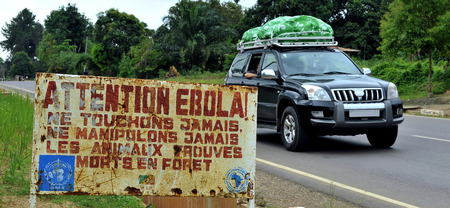 visitors area: MAKOUA, CONGO, AFRICA - SEPTEMBER 27: Car and sign warns visitors that area is a Ebola infected. Signage informing visitors that it is a ebola infected area. September 27, 2013,Congo, Africa. Editorial