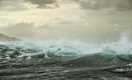 Ocean storm. Wave on the surface of the ocean. Wave breaks on a shallow bank Stock Photo
