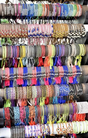 display case: Colorful bracelets on display case in street jewelry store