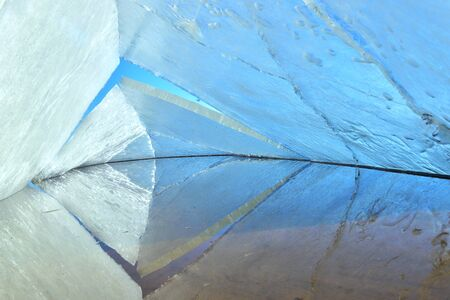 ice storm: kaleidoscope. the abstract background of ice structure. Winter. Ice on the surface of Lake .  Cracks in the ice surface. Ice storm.