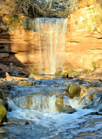 streamlet: Gorchakovschina waterfall near Volkhov River, district Leningrad region Russia