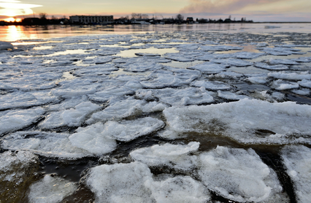 drifting ice: Panorama of river valley with spring ice drifting at sunset. Volkhov River Stock Photo