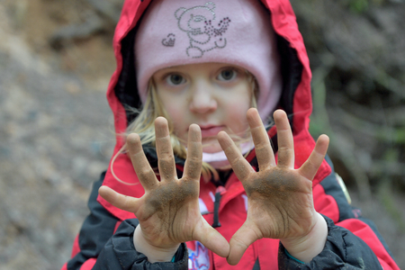 dirty: Little girl  with dirty hands.  outdoors.  child with dirty hands Stock Photo