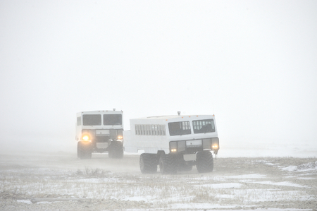 churchill: The all-terrain vehicle for snow trips to a snow blizzard in the tundra. Special car for the Arctic safari. Canada. Churchill National Park. Stock Photo