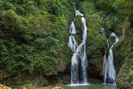 rain forest background: Waterfall in a lush rainforest. Vegas grande waterfall in Topes de Collante, Trinidad, Cuba