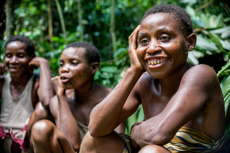 african tribe: DZANGA-SANHA FOREST RESERVE, CENTRAL-AFRICAN REPUBLIC (CAR), AFRICA, 2008 NOVEMBER 2: Jungle Portrait of a woman from a Baka tribe of pygmies. Dzanga-Sangha Forest Reserve, Central African Republic, Editorial