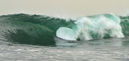 wave: Powerful ocean wave breaking. Wave on the surface of the ocean. Wave breaks on a shallow bank. Natural background