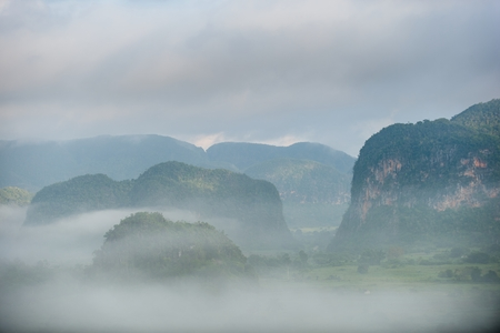 pinar: Aerial View across the Vinales Valley in Cuba. Morning twilight and fog. Fog at dawn in the Valley of Vinales in Pinar del Rio, famous for tobacco plantations in Cuba, world heritage site of Unesco
