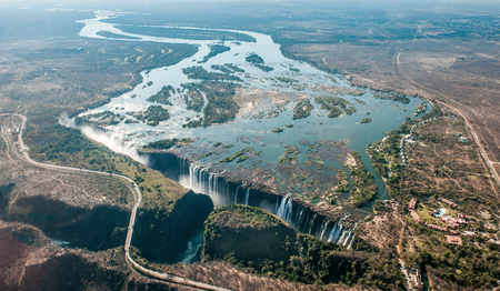 zambezi: Victoria falls on helicopter. Aerial view of Victoria Falls on Zambezi River, border of Zambia and Zimbabwe. Africa Stock Photo