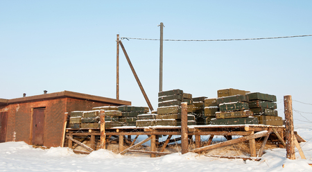 warheads: Military store ammunition and explosives behind barbed wire in the outdoors in winter