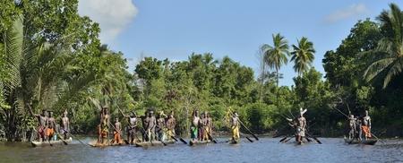 cannibal: INDONESIA, IRIAN JAYA, ASMAT PROVINCE, JOW VILLAGE - JUNE 23: Canoe war ceremony of Asmat people. Headhunters of a tribe of Asmat. New Guinea Island, Indonesia. June 23, 2016 Editorial