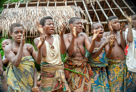 DZANGA-SANHA FOREST RESERVE, CENTRAL-AFRICAN REPUBLIC (CAR), AFRICA, 2008 NOVEMBER 2: People from a tribe of Baka pygmies in village of ethnic singing. Traditional dance and music. Nov, 2, 2008 CAR
