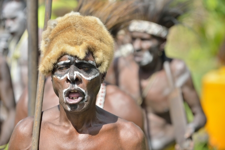 YOUW VILLAGE, ATSY DISTRICT, ASMAT, NEW GUINEA, INDONESIA - MAY 23:  The Village follows the ancestors embodied in spirit mask as they tour the village. Jjungle of New Guinea.Indonesia. May 23, 2016